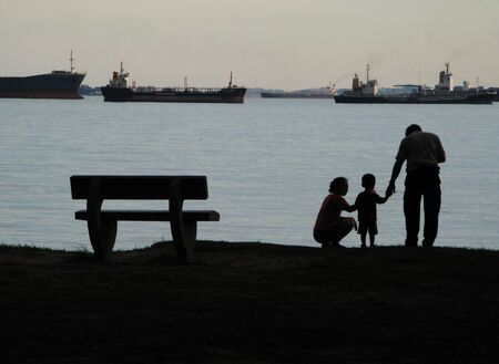 Silhouette of people relaxing at the beach in East Coast Park, Singapore