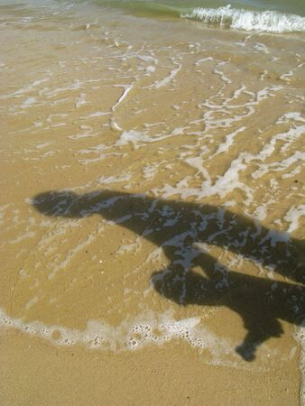 Shadow of mother and child at the beach.   Stock Photo - 2221441