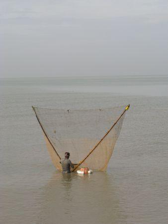 Fisherman using traditional method