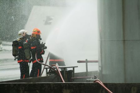 defense: Civil Defence officers are trainied to cope with natural disasters of any sorts in Singapore Stock Photo