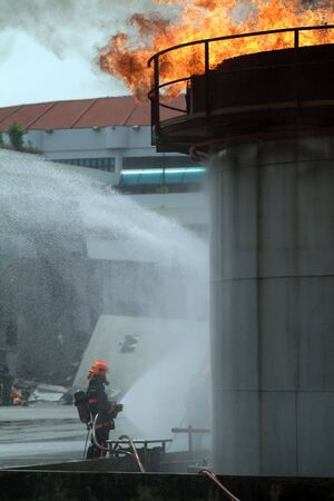 cope: Civil Defence officers are trainied to cope with natural disasters of any sorts in Singapore Stock Photo