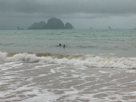 People swimming in Stormy weather in Krabi photo