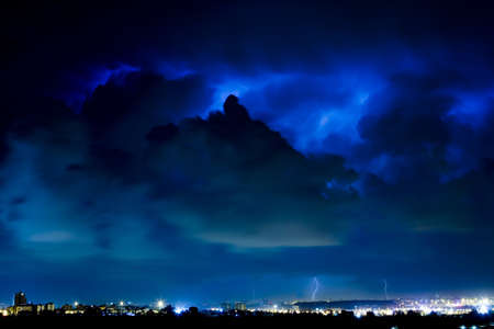 Lightning Storm In The Night Dark Blue Clouds Over A Lighted City Stock