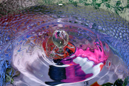 wavelet: still life picture, drop of water creating a wavelet Stock Photo