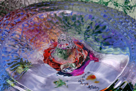 wavelet: still life picture, drop of water creating a wavelet shaped like a bowl