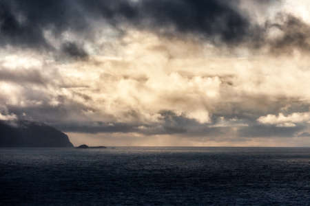 KRAAKENES LIGHTHOUSE, NORWAY - 2015 NOVEMBER 15. Sea view from Kraakenes Lighthouse with dark clouds in the background.