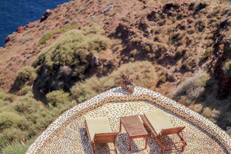SANTORINI, GREECE - 2013 august. Two sunbed with view.