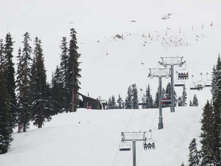 Snowy winter scene high in the mountain. Arapahoe Basin ski resort. Colorado Rocky Mountains USA. photo