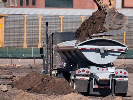 Excavator at work on the construction site. Banco de Imagens