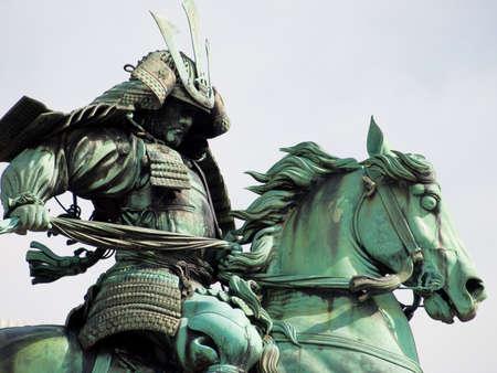 Samurai worrior sculpture in city park in Tokyo.