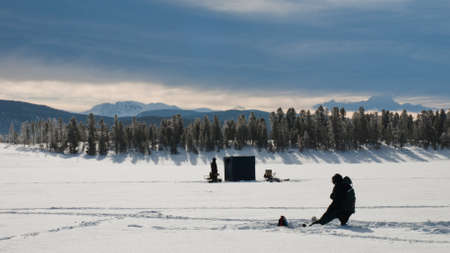 Ice fishing on Lake Granby, Colorado. photo