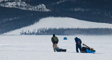 Ice fishing on Lake Granby, Colorado. Stock Photo - 8918065