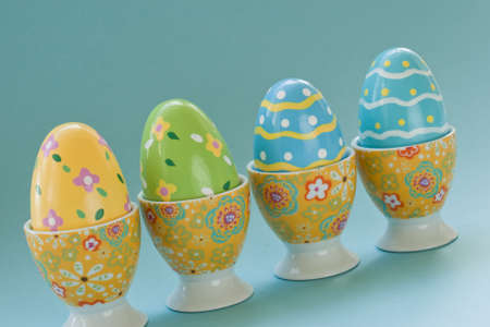 Painted easter eggs in egg cups. photo