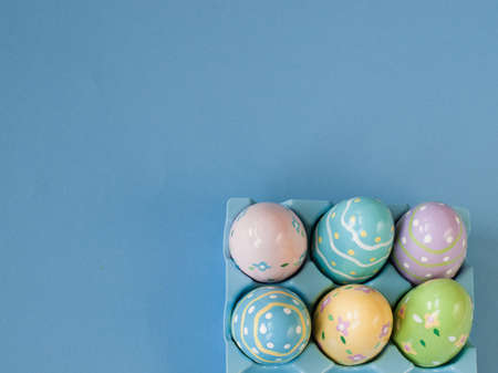 Box with painted easter eggs. photo