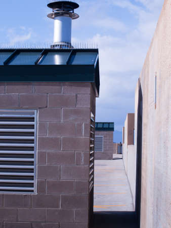 Mechanical room with exhaust chimney on the top of the parking structure. Reklamní fotografie - 9327053
