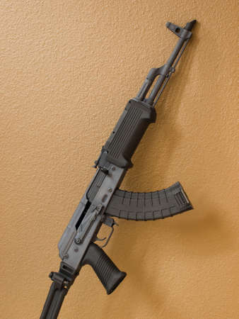 guerilla warfare: Custom painted AK-47 with a 30 round magazine and a folding stock.