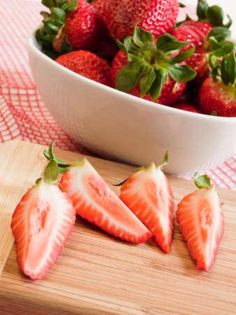 Fresh ripe strawberries in white bowl. Reklamní fotografie