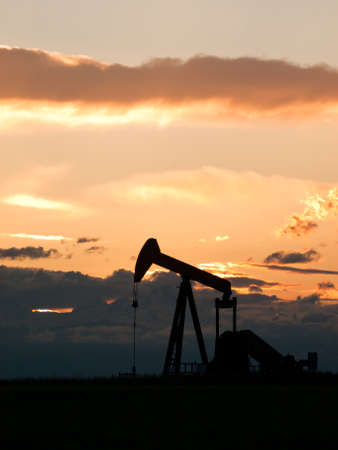 A pumpjack silhoutte with dramatic sunset. Stock Photo - 9592574