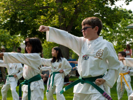 Belt test at J.W. Kim TaeKwonDo School. At the park in Greenwood Village, Colorado. June 2011. Stock Photo - 9671520