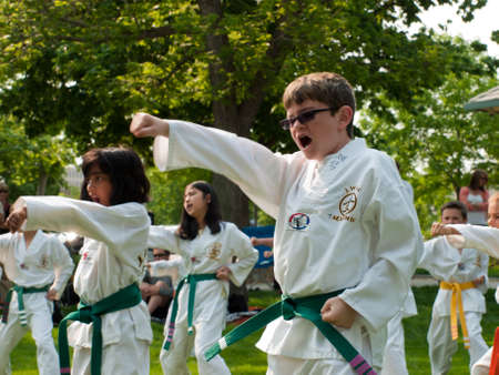 Belt test at J.W. Kim TaeKwonDo School. At the park in Greenwood Village, Colorado. June 2011. Stock Photo - 9671525