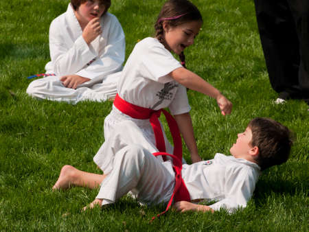 Belt test at J.W. Kim TaeKwonDo School. At the park in Greenwood Village, Colorado. June 2011. Stock Photo - 9671589