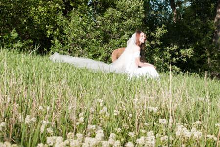 Fashion model wearing a wonderful  wedding dress. Stock Photo - 9743398