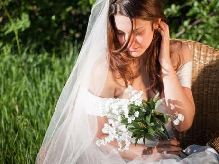 Fashion model wearing a wonderful  wedding dress. Stock Photo - 9743231