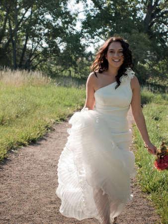 Fashion model wearing a wonderful  wedding dress. photo
