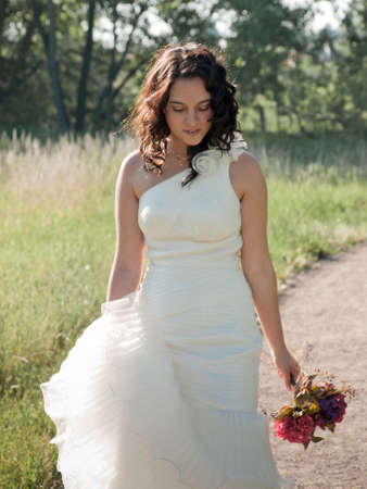 Fashion model wearing a wonderful  wedding dress. Stock Photo - 9743466