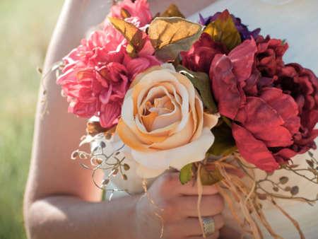 flower bunch: Wedding bouquet in hands of the bride. Stock Photo