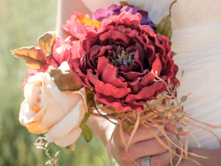Wedding bouquet in hands of the bride. Stock Photo - 9743437
