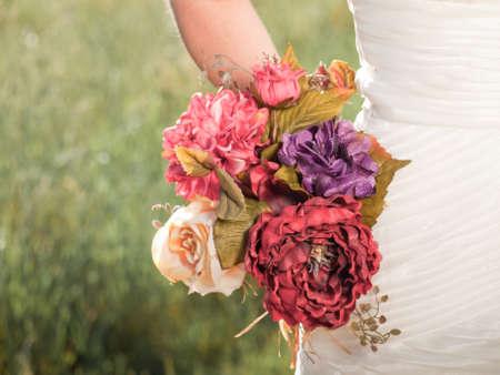 Wedding bouquet in hands of the bride. photo