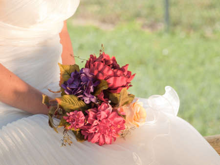 Wedding bouquet in hands of the bride. photo