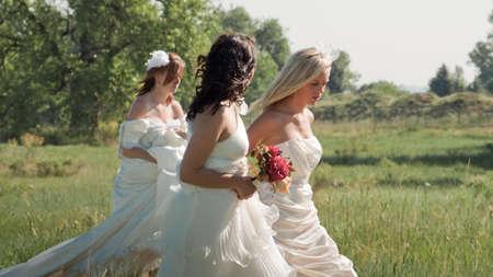 Fashion models wearing a wonderful  wedding dresses. photo