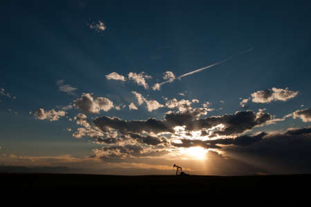 A pumpjack silhoutte with dramatic sunset. Stock Photo - 9743684