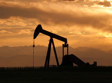 A pumpjack silhoutte with dramatic sunset. Stock Photo - 9743683