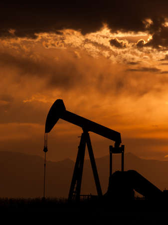 A pumpjack silhoutte with dramatic sunset. Stock Photo - 9743646