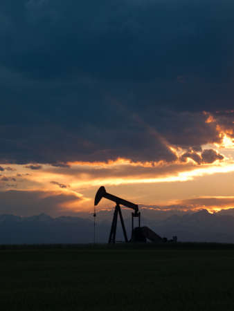 oil and gas industry: A pumpjack silhoutte with dramatic sunset.