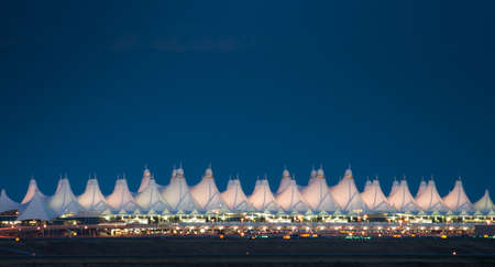 building feature: Denver International Airport at night against dark sky.