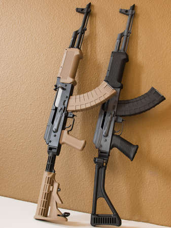 Custom painted AK-47 with a 30 round magazine and a folding stock. Stock Photo - 9907466