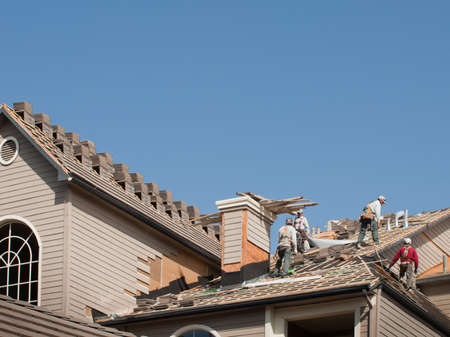 Roof repairs of an apartment building in Colorado. Editorial