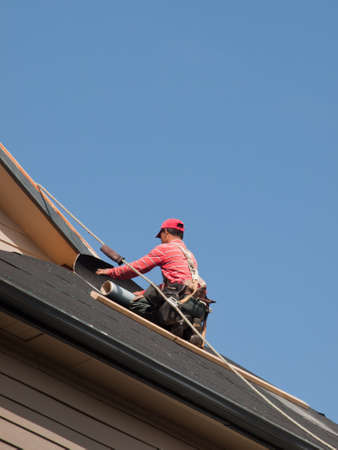 Roof repairs of an apartment building in Colorado. Stock Photo - 9907494