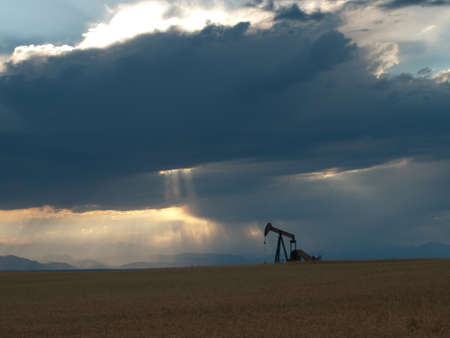 A pumpjack silhoutte with dramatic sunset. Stock Photo - 10041922