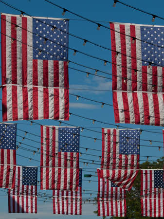 mile high holidays: Larimer Square in Denver, Colorado with american flags.