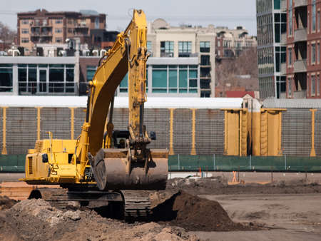 Excavator at work on the construction site. Editorial