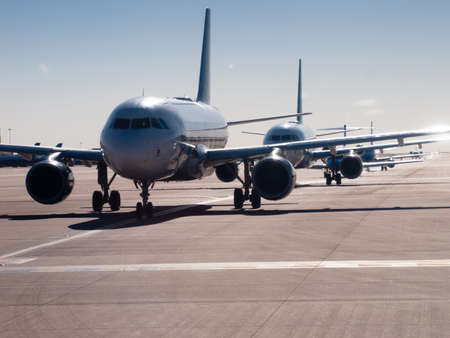 Airplanes lined up before departure. Editorial