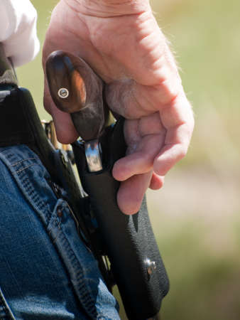 Man with loaded moon clips for revolver. photo