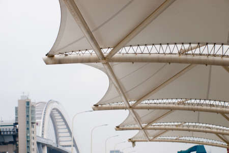 Contemporary canopy of elevated pedestrian walkway at the EXPO 2010 Shanghai, China.