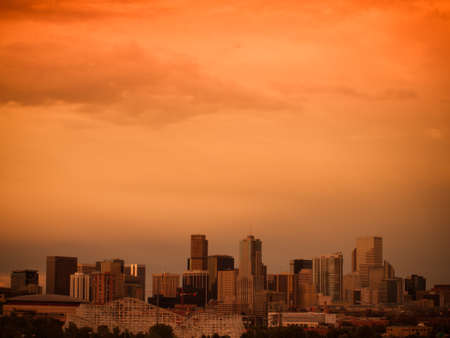 denver skyline: A view of Denver, Colorado downtown right before sunset Editorial
