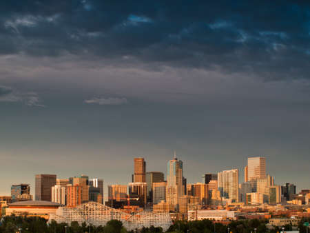 denver skyline at sunset: A view of Denver, Colorado downtown right before sunset Editorial